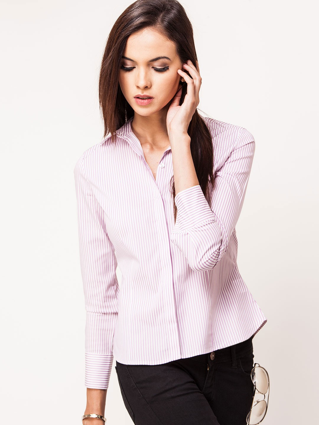 Shop for women's shirts in different materials such as cotton, silk, synthetic and more. Take your pick for a formal ensemble or choose from a wide range of printed shirts in bright and beautiful colours that give you the look you desire.