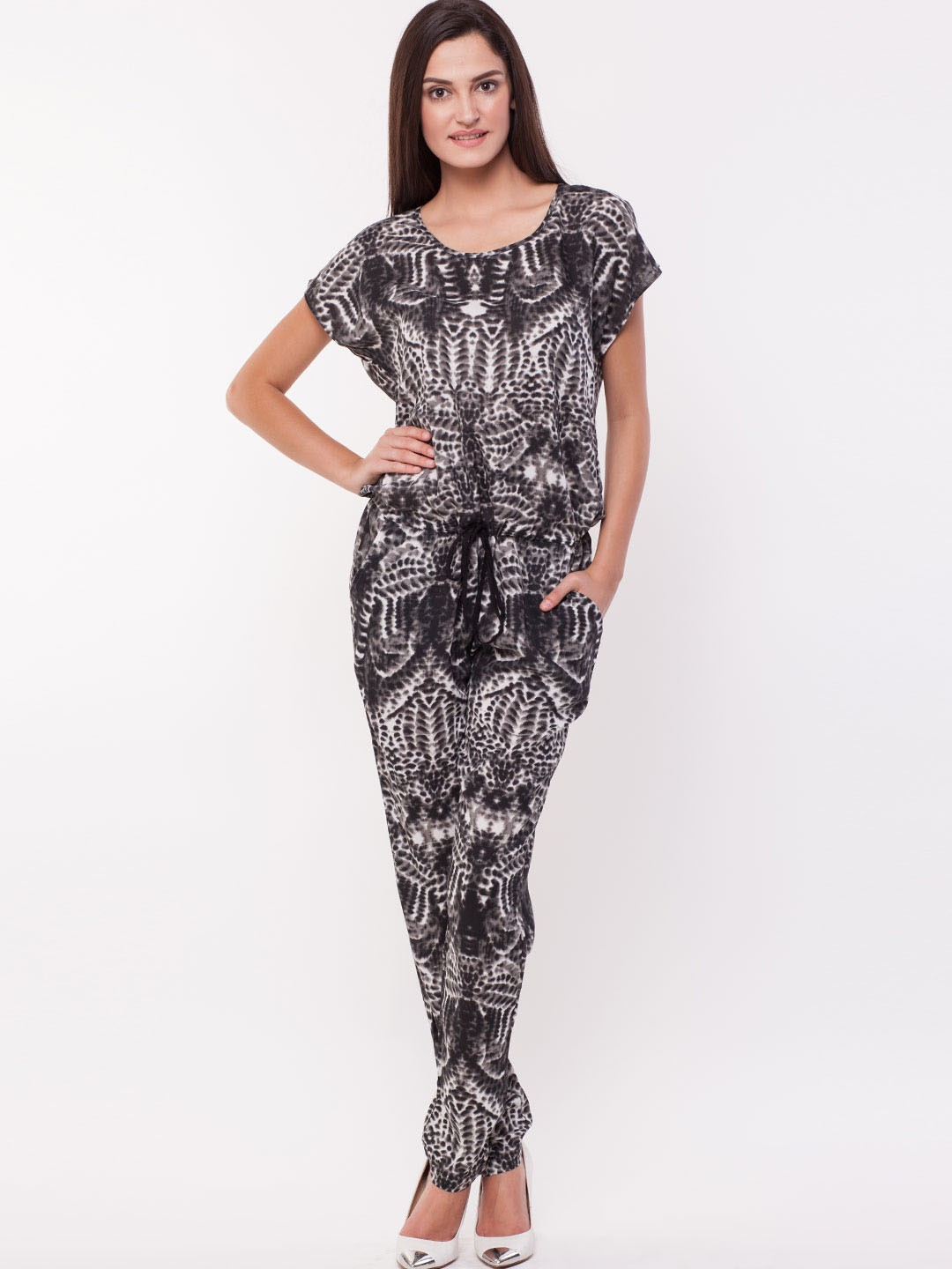 DESIGNER JUMPSUITS, LACE JUMPSUITS, AND WIDE LEG JUMPSUITS. Look fabulous while wearing on-trend one-piece women's jumpsuits. Get dressed and ready to hit the town in five minutes or less with effortless jumpsuit outfits.