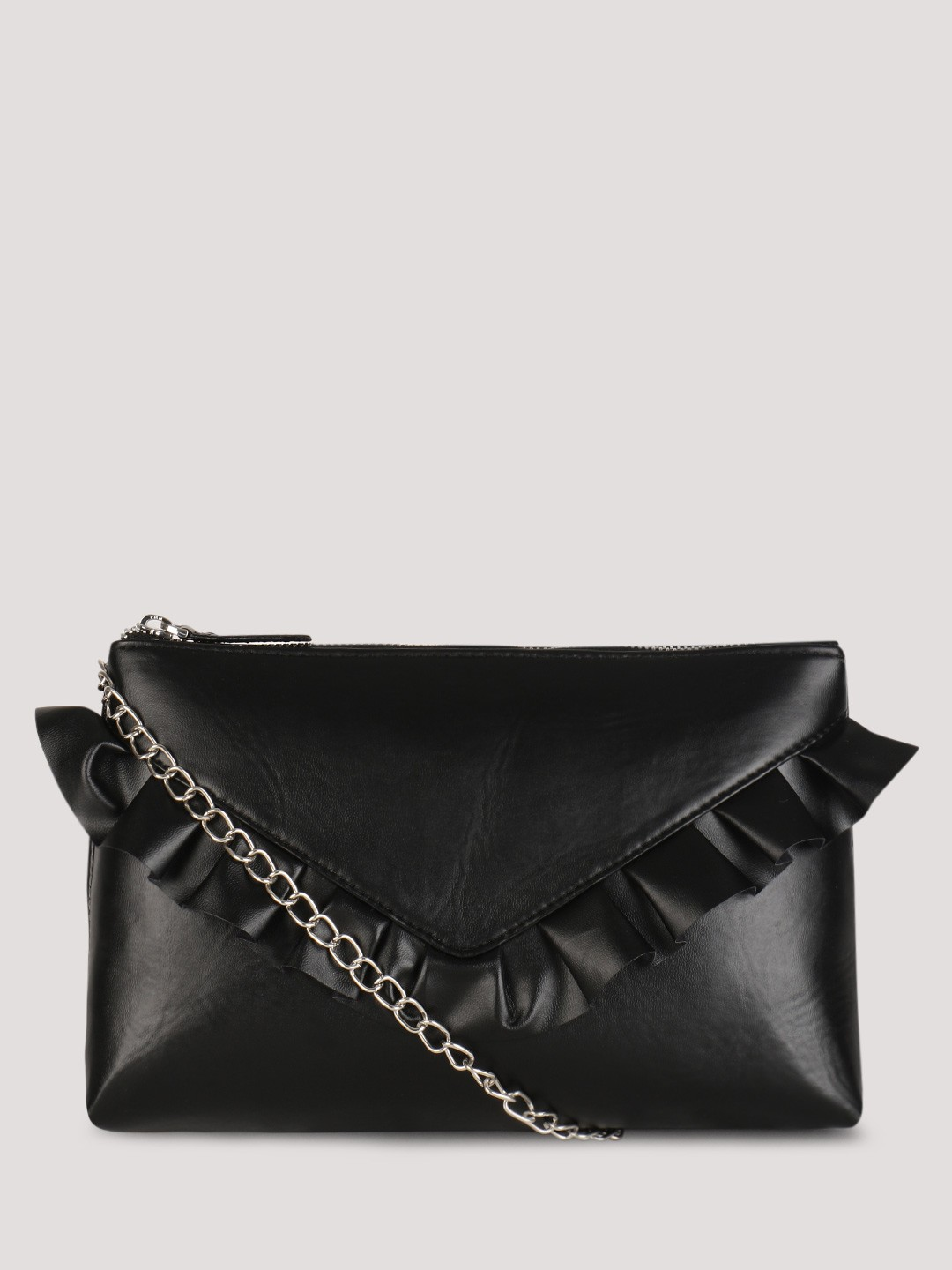 Our clutch with pretty Faux Pearls is a must-have party essential. The chic chain strap makes this bag versatile for day (wear as a crossbody or over-the-shoulder) and for night (use as a clutch) looks. Black clutch with Faux Pearls Kisslock closure with goldtone hardware Chain shoulder strap with 21